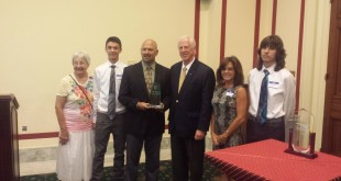 Scott De Leon, Director of the Lake County Water Resources Department (third from left), and Congressman Mike Thompson (fourth from left) surrounded by family after receiving special recognition at the Reduce Risks from Invasive Species Coalition (RRISC) Congressional Reception and Awards Program. (COURTESY / On File)