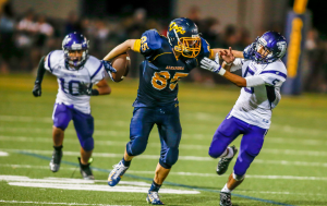 Alhambra tight end Josh Abraham delivers a big stiff arm to the College Park defender during the opening game of the season at Knowles Field in Martinez, Friday, Aug. 28, 2015. (NEVILLE GUARD / Martinez Tribune)