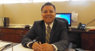 Richard Muñoz at his desk at Connolly & Taylor in Martinez. (E. CLARK / Martinez Tribune)