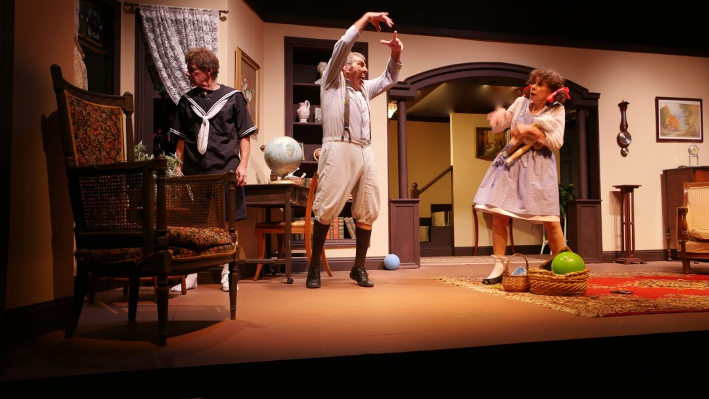 "From left: Willy (Wayne McRice) looks out the window while Neil (Sal Russo) tells recoiling Hannah (Sheilah Morrison) how truly scary The Dark outside is during opening night of ""Let Me Hear You Smile"" at Campbell Theater in downtown Martinez, Saturday, Aug. 22, 2015. (JAMIE JOBB / Courtesy)"
