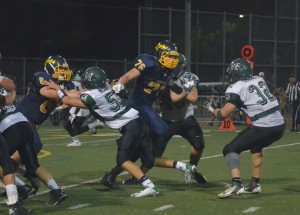 Alhambra lineman Dante Abono busts through the line of scrimmage to make a play against the Miramonte Matadors in the Bulldogs' 42-19 loss on Sept. 25, 2015. (GERARDO RECINOS / Martinez Tribune)