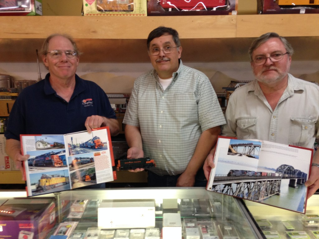 Train enthusiasts Jeffrey Ferris (left), Jim Anthony (center) and author Ed Mackinson. (DONNA BETH WEILENMAN / Martinez Tribune)