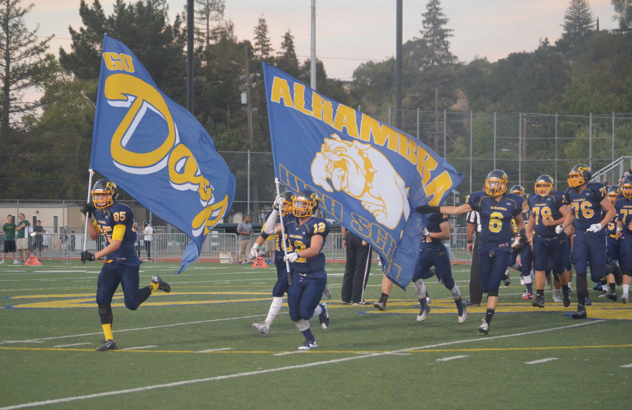 josh Abraham (85) and Jonathan McCart lead the Bulldogs out onto the field before the team's 42-19 loss to the Miramonte Matadors on Sept. 25, 2015. (GERARDO RECINOS / Martinez Tribune)