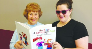 "Jacque Hall (left) and granddaughter Jennifer Oertel display their book, ""The ABCs of Carrots and Peas!"" (DONNA BETH WEILENMAN / Martinez Tribune)"