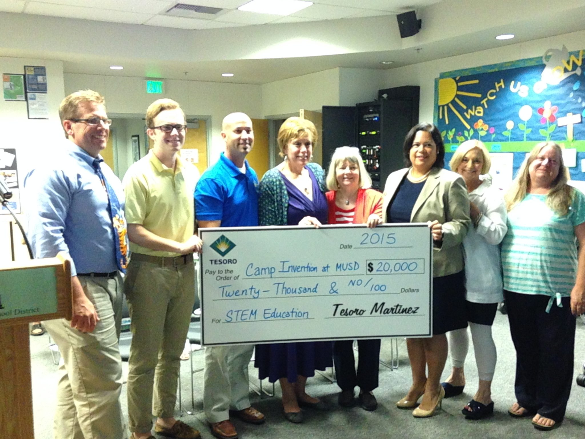 "Tesoro gifts the Martinez Unified School District (MUSD) STEM education camp, ""Camp Invention,"" with a check for $20,000. From left: MUSD Chairman John Fuller, student representative Blake Johnson, Tesoro's Brian Nunnally, MUSD Superintendent Rami Muth, Boardmember Kathi McLaughlin, Vice Chairperson Deidre Siguenza, Clerk Bobbi Horack and Boardmember Denise Elsken. (DONNA BETH WEILENMAN / Martinez Tribune)"