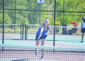 Alhambra number three singles player Veronika Olson serves to her College Park opponent on Sept. 2, 2015, at Alhambra High in Martinez. (GERARDO RECINOS / Martinez Tribune)