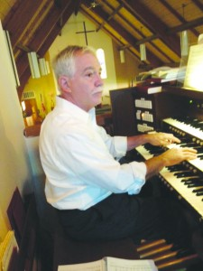 Organist and choirmaster Alfred Gary Evans playing the organ at Grace Episcopal Church in Martinez. Hear Evans and the Grace Choir during Sunday morning services, 10 a.m., Grace Episcopal Church, 130 Muir  Station Road, Martinez. (BOB BURMAN / Courtesy)