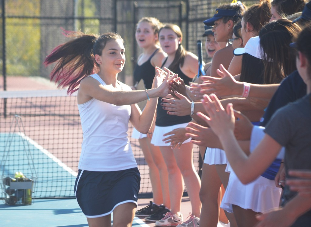 Alhambra number five singles player Ava Garashabi goes down the line high-fiving teammates before the Bulldogs' match against the Miramonte Matadors on Tuesday, Oct. 13, 2015. (TOD FIERNER / Courtesy)