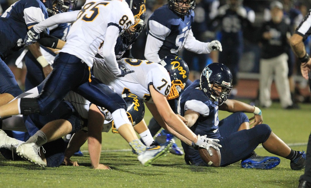 Alhambra lineman Dante Abono is the first to reach the loose ball in the Bulldogs' 35-7 victory over the Dougherty Valley Wildcats on Friday, Oct. 23, 2015. (TOD FIERNER / Courtesy)