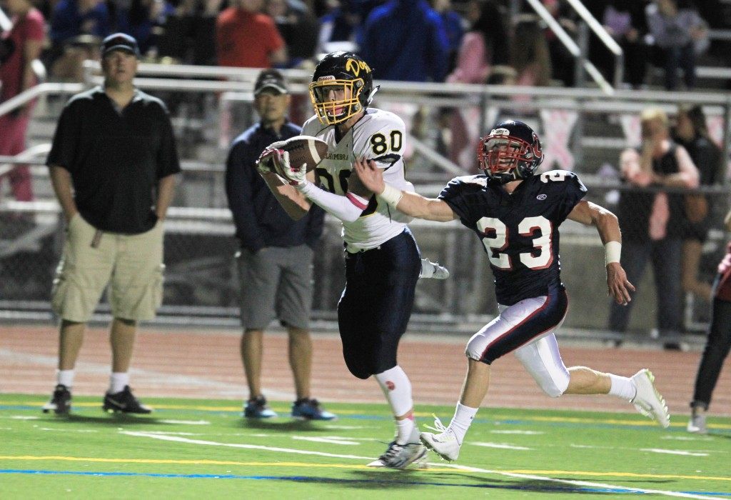 Alhambra receiver Jeremy Abraham hauls in the first Alhambra touchdown of the night on a 35-yard pass from quarterback Zach Elliott in the Bulldogs' 47-20 loss to Campolindo on Friday, Oct. 9, 2015. (TOD FIERNER / Courtesy)