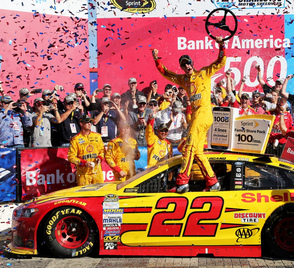 Joey Logano, driver of the No. 22 Shell Pennzoil Ford, celebrates in Victory Lane after winning the NASCAR Sprint Cup Series Bank of America 500 at Charlotte Motor Speedway on October 11, 2015 in Charlotte, North Carolina. (Jerry Markland/Getty Images/courtesy)
