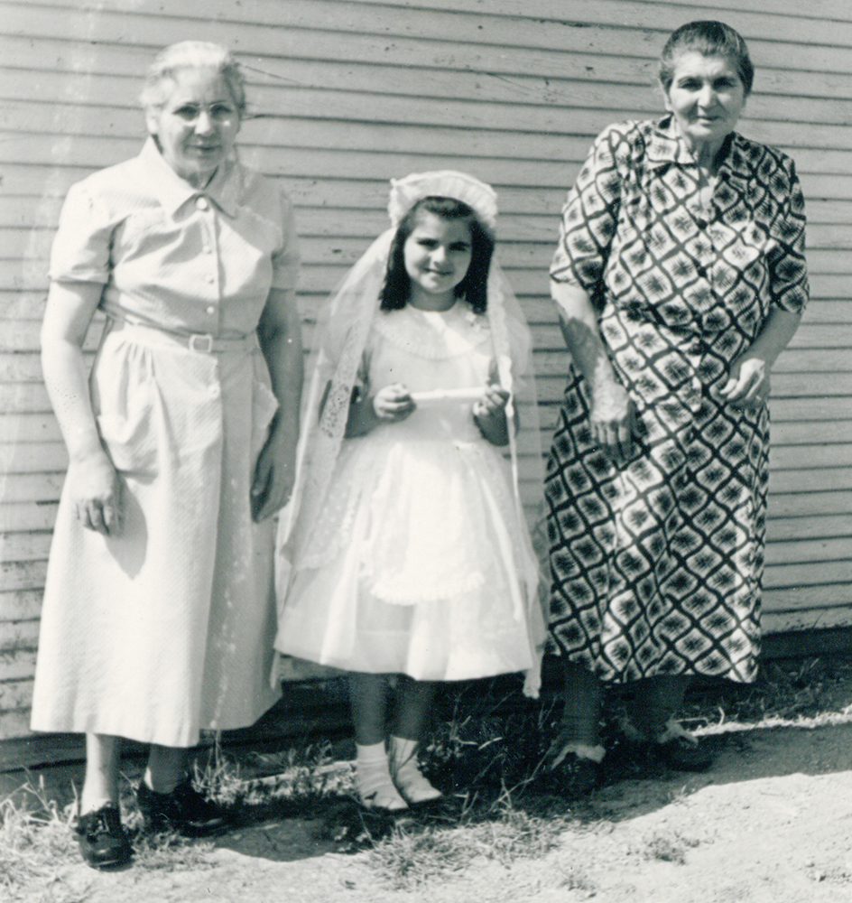 From left: Nana Maria Carone, Mary Carone Nicholson and Nana Grace Billecci, during Mary's 2nd Grade Holy Communion. The picture was taken outside the Billecci home at 425 Talbert St., Martinez, circa 1954-1955. (MARY CARONE NICHOLSON / Courtesy)