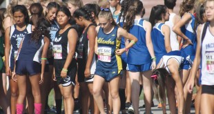 Alhambra freshman runner Nicole Tria prepares for the start of her race on Friday, Oct. 23, 2015 at Mt. San Antonio College in Walnut, California. Tria came in eighth place in her division and won the only Bulldog medal of the day. (DARREN CHAVEZ / Courtesy)