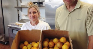 Loaves & Fishes dining room manager Debbie Gerlosky (at left), and program executive director David Gerson, display produce that will be served from the kitchen at Loaves & Fishes' new location at 835 Ferry St., Martinez. (DONNA BETH WEILENMAN / Martinez Tribune)