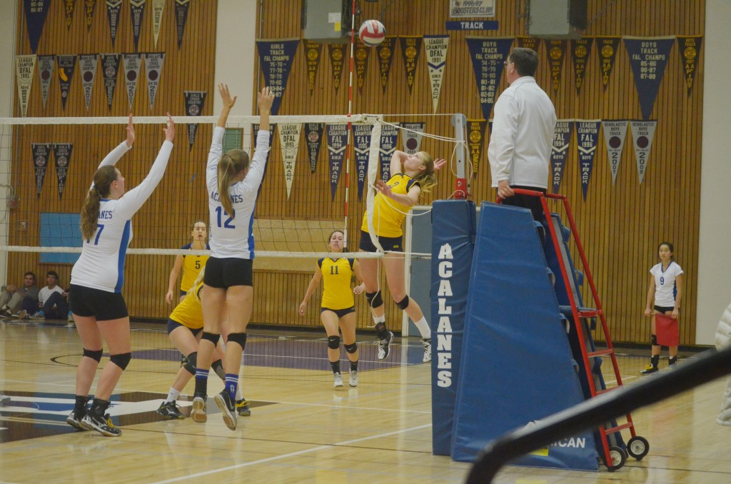 Alhambra's Sophia Jones (center) rises up to hit the ball in the second set of the Bulldogs' 3-0 loss to the Acalanes Dons on Tuesday, Nov. 3, 2015. (GERARDO RECINOS / Martinez Tribune)