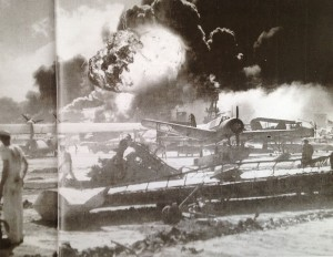 Smoke billows after Japanese planes drop bombs on Pearl Harbor Dec. 7, 1941. Veteran Chuck Kohler may have been one of the first to be wounded by shrapnel in the attack. (COURTESY / On File)