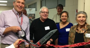Participating Thursday night, Nov. 19, 2015, in the ribbon cutting at Loaves & Fishes, 835 Ferry St., Martinez, are, from left: Loaves & Fishes Executive Director David Gerson, Martinez Mayor Rob Schroder and Loaves & Fishes Boardmembers Cliff Seaholm, Raminder Somal and Rhea Bennett. (DONNA BETH WEILENMAN / Martinez Tribune)