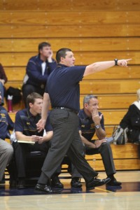 Newly promoted varsity boys basketball coach Anthony Ertola directs his players in the Bulldogs' season opener on Tuesday, Dec. 1, 2015, against Tamalpais High School. Ertola was a member of the Bulldog basketball team from 2006-2008. (MARK FIERNER / Martinez Tribune)