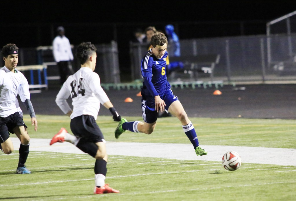 Alhambra junior Jack Fuller races down the wing in the Bulldogs' 2-0 victory over the Hercules Titans on Monday, Dec. 14, 2015. (MARK FIERNER / Martinez Tribune)