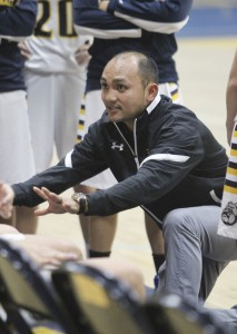 Alhambra varsity girls basketball coach Jason Bautista talks to his team during a timeout in the Lady Bulldogs' 44-30 win over the Petaluma High School Trojans on Tuesday, Dec. 8, 2015. Bautista took over the varsity girls job after spending time at every level of the Bulldog basketball program. (MARK FIERNER / Martinez Tribune)