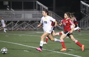 Alhambra sophomore Julia Perez runs by her defender. Perez scored twice in the 9-1 win over De Anza on Dec. 7, 2015. (MARK FIERNER / Martinez Tribune)