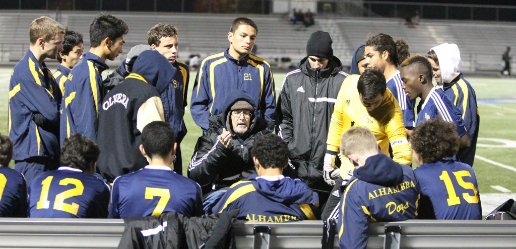 Alhambra head varsity soccer coach Rory Gentry (center) addresses his team prior to the Bulldogs' 2-0 win over Hercules on Dec. 14, 2015. (MARK FIERNER / Martinez Tribune)