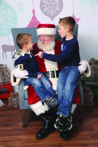 Pleasant Hill residents Robert Schofield, 4, (at left) and his brother, Kyle, 8, (far right) chat with Santa on Dec. 22, 2015, at Santa's chalet along Main Street in downtown Martinez. (NICOLE diGIORGIO / www.sweetnessandlightphoto.com)