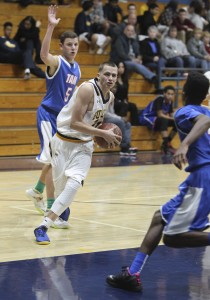 Junior guard Thomas McDonald shoots by defenders in the Bulldogs' 61-49 loss to the Tamalpais Red-Tailed Hawks on Tuesday, Dec. 1, 2015. (MARK FIERNER / Martinez Tribune)