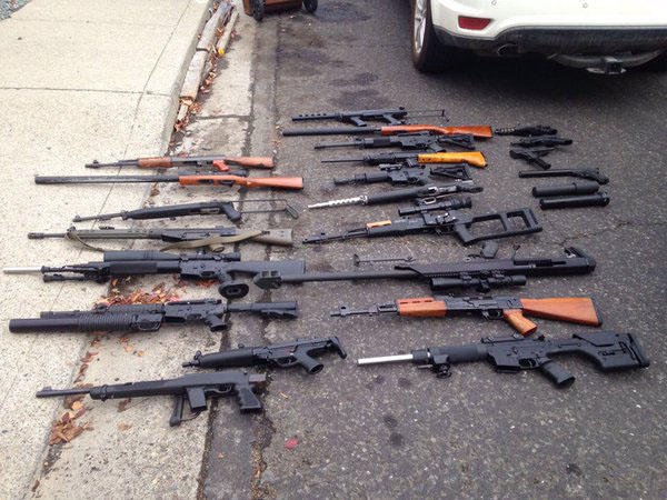 Some of the firearms seized from the Martinez home of Sterling Hartwell Albert, charged with possessing a still, selling alcoholic beverages without a license, and possession of illegal and unregistered firearms. (MELANIE WOODROW / Twitter)