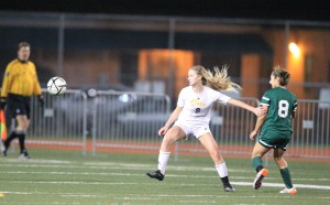 Alhambra full back Katie Christman shields her attacker off the ball in the Bulldogs' 2-1 win over Miramonte. (MARK FIERNER / Martinez Tribune)