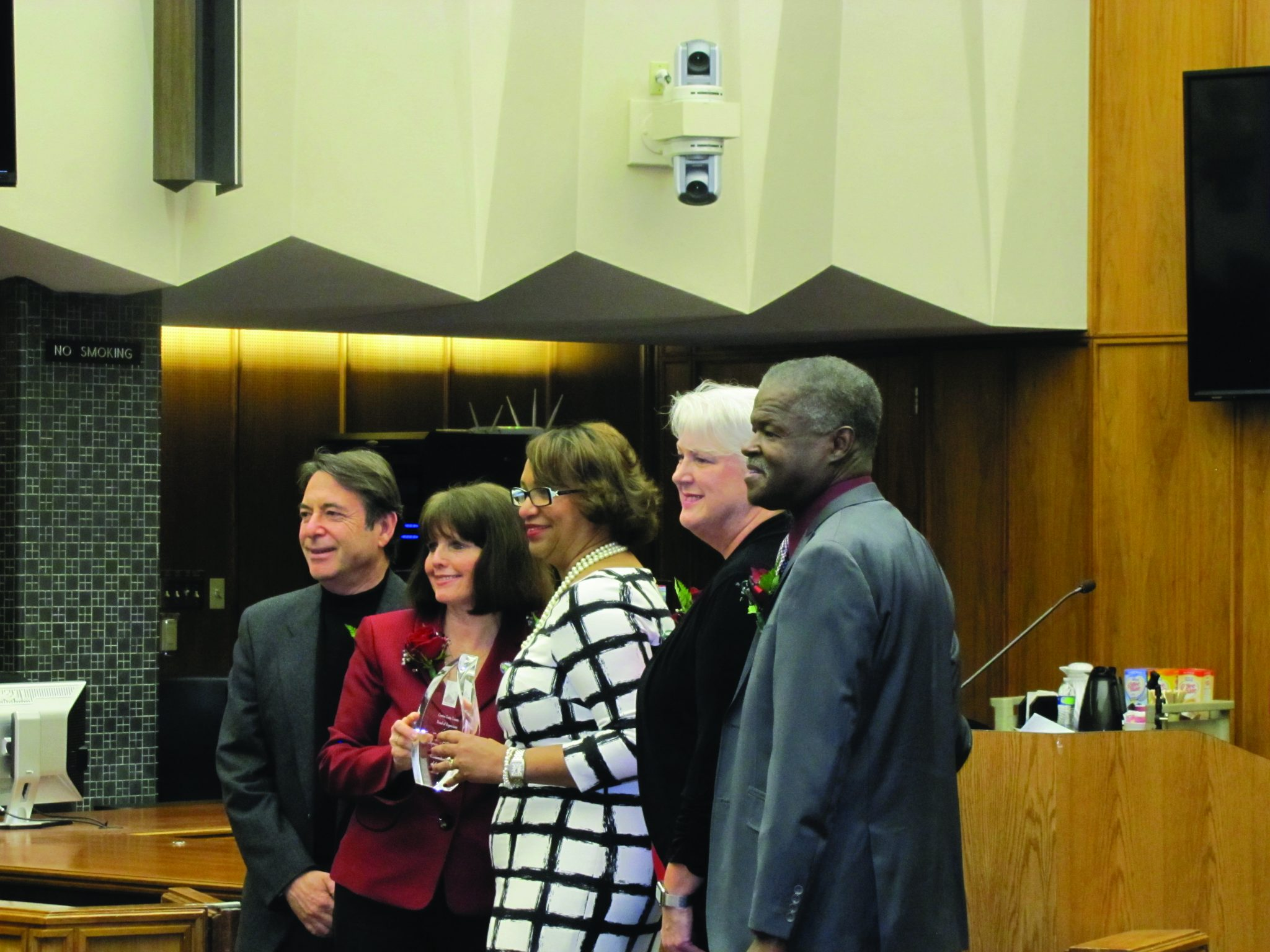 Terri Porter (center) receives the 2016 Humanitarian of the Year Award Tuesday, Jan. 19, during a special ceremony honoring the memory of Dr. Martin Luther King Jr. in the chambers of the Contra Costa County Board of Supervisors. From left: Supervisor John Gioia (District 1), Supervisor Candace Andersen (District 2), Porter, Supervisor Karen Mitchoff (District 4), and Supervisor Federal Glover (District 5, representing Martinez). Not pictured is District 3 Supervisor Mary Piepho. (HANNAH HATCH / Martinez Tribune)