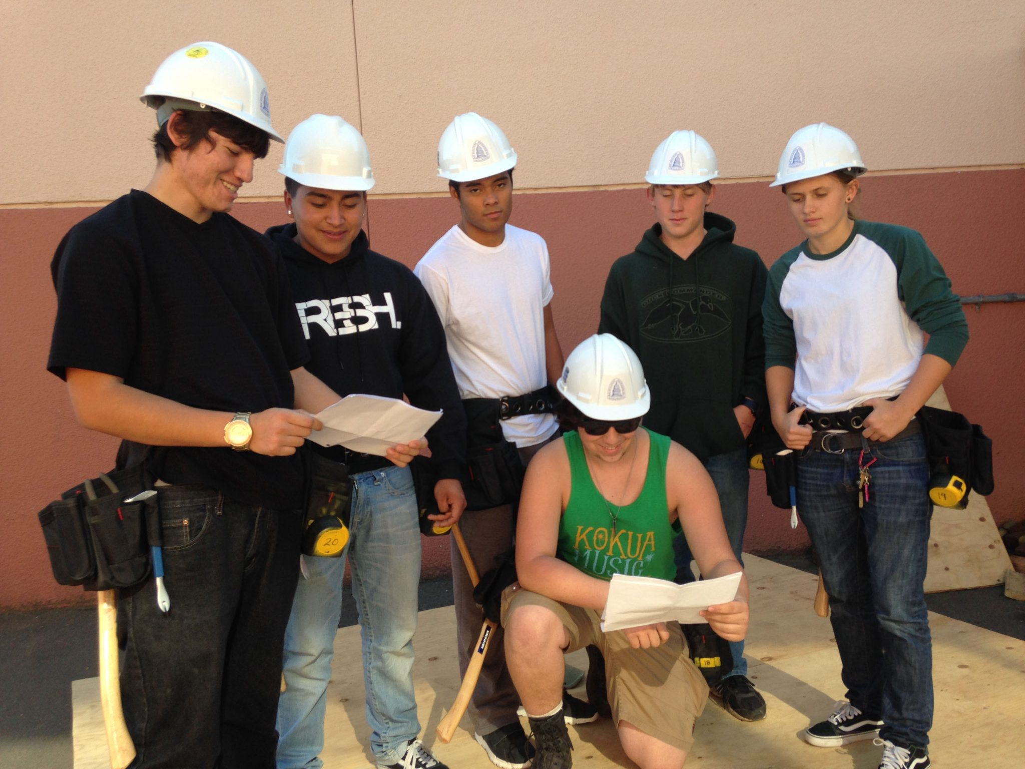 In front is Jack Millson, and in back are, from left, Jhonathan Zamora, Ricky Guerrero, Ricky Lopez, Jared Glemser and Lexi Rosales, of the Alhambra High School class of woodworkers who are checking designs of storage sheds their class will build and sell. (DONNA BETH WEILENMAN / Martinez Tribune)