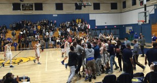 Fans rushed the court after the Bulldogs' 55-50 win over the playoff-bound Acalanes Dons on Friday, Feb. 19, 2016. Senior josh Ramirez had 18 points in the win in his final game as a Bulldog. (GERARDO RECINOS / Martinez Tribune)