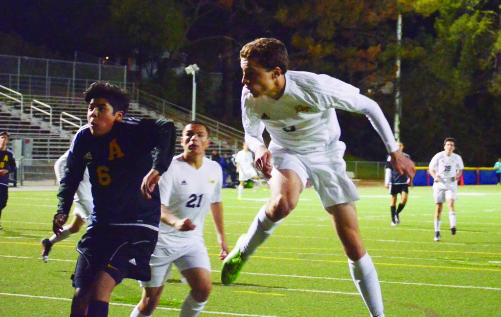 Junior winger Jack Fuller (6) rises high to head the ball from a corner kick in the first half of the Alhambra Bulldogs' 3-3 draw with the Alameda Hornets on Monday, Feb. 1, 2016. Fuller's attempt on goal was not ruled a goal, but the junior made up for it. He was involved in all three goals in the second half, scoring twice and assisting teammate Raul Mosqueda's game-tying effort. (GERARDO RECINOS / Martinez Tribune)