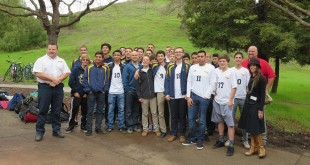 """The Alhambra High School Boys Soccer Team, flanked by sponsors Dwayne Glemser (far left) of Les Schwab Tire Center, Matthew Rinn (far right) of State Farm Insurance and Anne Baker of Republic Services (far right) at the AHS campus Jan. 29, 2016. The soccer team received a monetary bonus on the day for assisting the """"Scare Away Hunger"""" program, bringing in 1,900 pounds of food plus financial donations for the Food Bank. (DANNY YOEONO / Martinez Tribune)"""