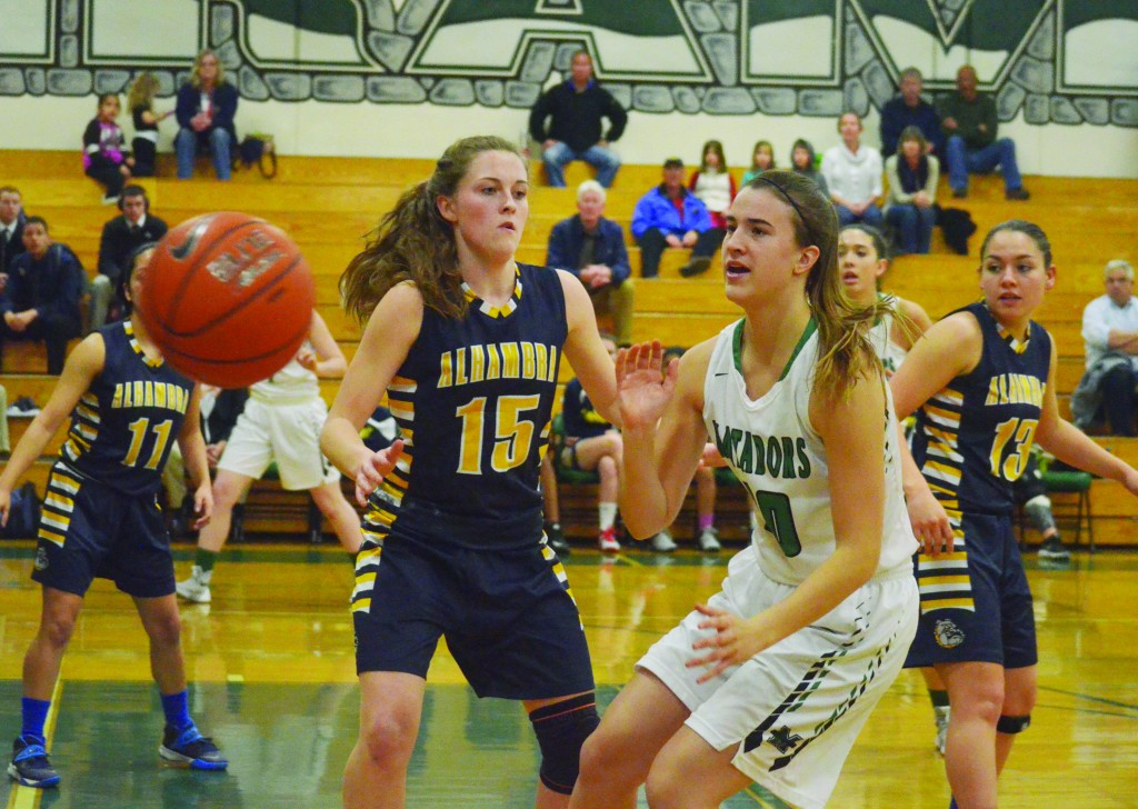 Alhambra guard Saelym Schmidt (15) was the Bulldog tasked with guarding Miramonte senior Sabrina Ionescu (20) in the Bulldogs' 76-30 loss to the nation's seventh best high school girls basketball team. Ionescu had 12 points in limited action. (GERARDO RECINOS / Martinez Tribune)