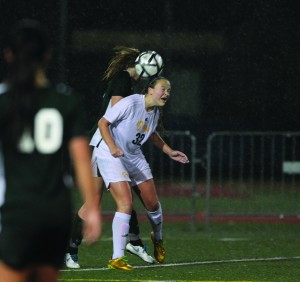 Alhambra's Ashley McClearnen battles for the ball in rainy conditions at Knowles Field. Frequent rains have effected scheduling as well as overall play. (TOD FIERNER / Martinez Tribune)