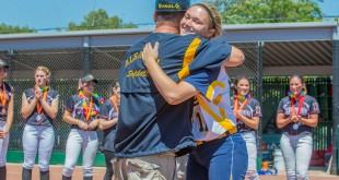 Alhambra senior Cara DiMercurio embraces with coach Paul Buccellato after winning the North Coast Section Division II title game. DiMercurio is one of only three seniors on the Lady Bulldog softball team. DiMercurio has signed on to play at St. Mary's College next year. (NEVILLE GUARD / Martinez Tribune)
