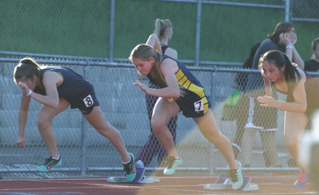 Alhambra's Jenna Coffman (right) takes off the starting blocks in the frosh/soph girls 100-meter dash on Wednesday, March 16, 2016. Coffman won with a time of 13.48 seconds. Coffman won three events on the day, including the triple jump and 4x100 relay. (GERARDO RECINOS / Martinez Tribune)