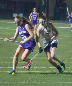 Alhambra's Kelby Fuss (5) scored twice in the Lady Bulldog lacrosse team's 12-4 loss to the College Park Falcons on Thursday, Feb. 25, 2016. The game was the Bulldogs' season opener. They won their next game on Feb. 27, against Windsor. (GERARDO RECINOS / Martinez Tribune)