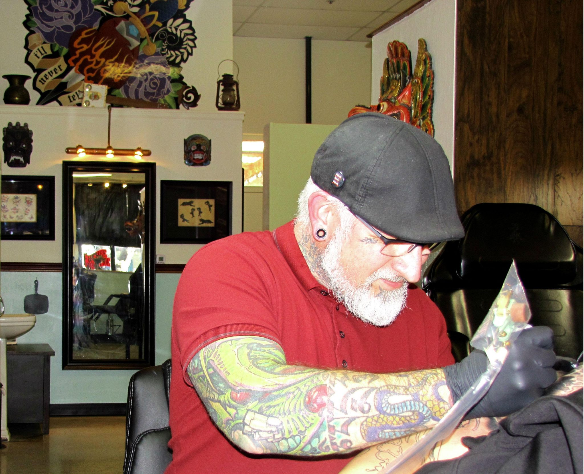 Tee Jay  Hernandez works on a tattoo at his shop on Main Street in downtown Martinez. Hernandez, a renowned artist,  services a nation-wide clientele. (HANNAH HATCH / Martinez Tribune)
