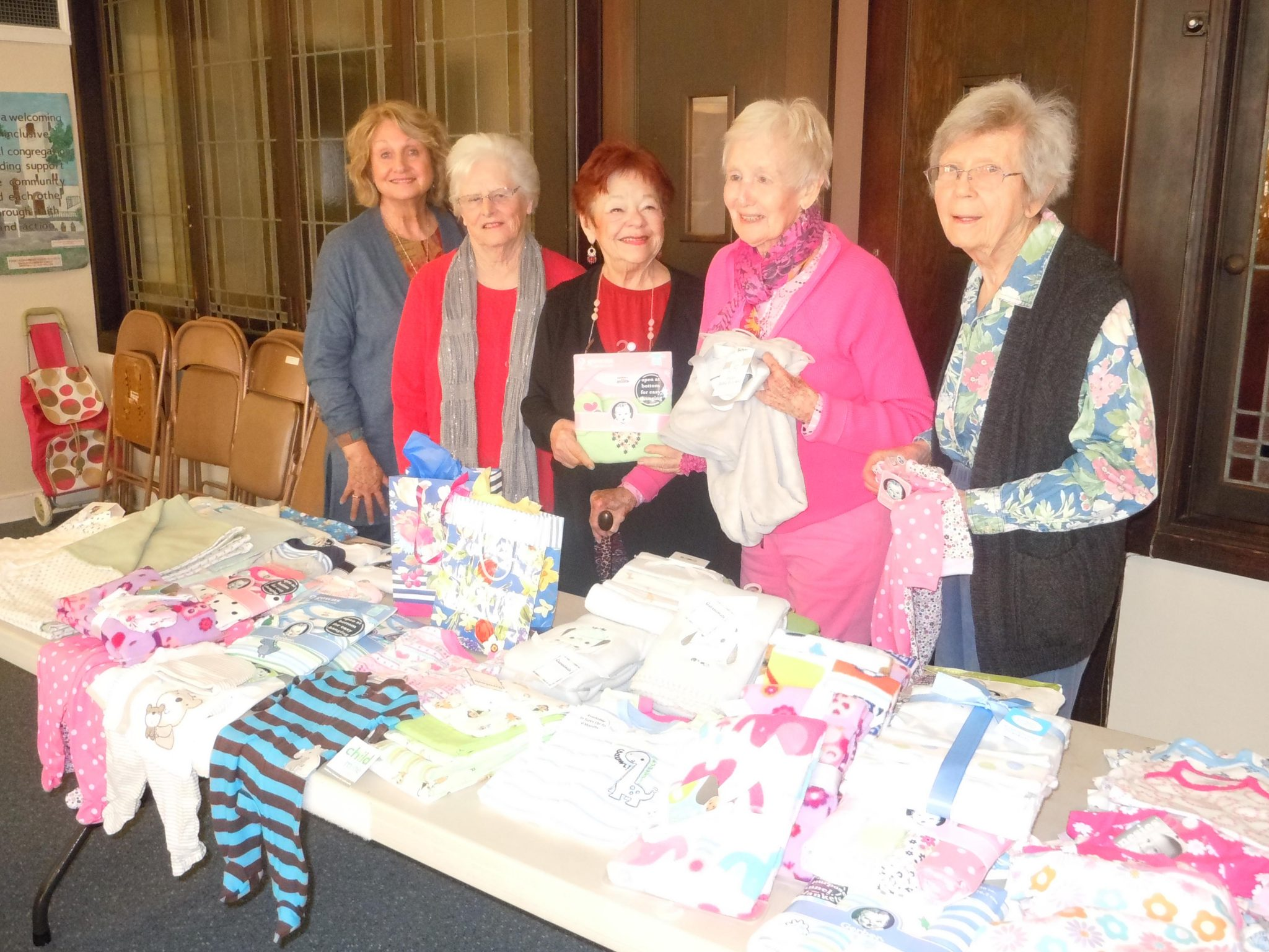Priscilla Circle ladies of the Martinez Congregational Church display the baby items from their 18th annual Grandma Baby Shower. They are Linda Martinot, event chairman Betty Holt, Georgia Stockton, Doris Parks, and Carol Baier. (COURTESY / On File)