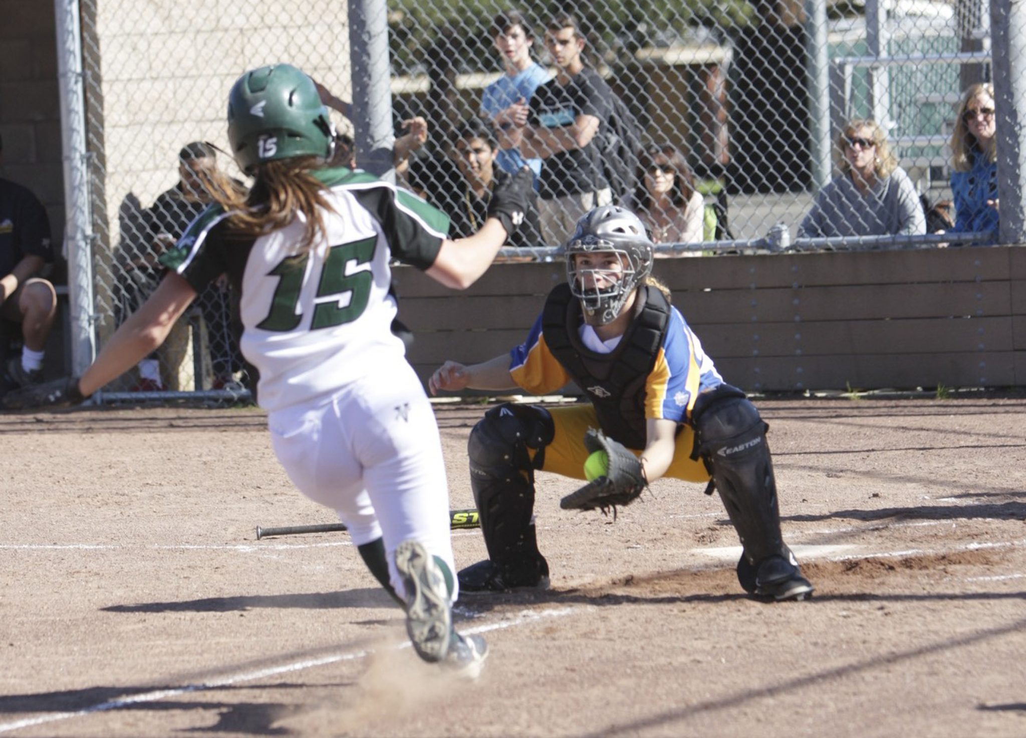 Alhambra senior catcher Cara DiMercurio awaits the sliding runner at home in the Bulldogs' 24-2 win over the Miramonte Matadors on Thursday, March 31, 2016. (MARK FIERNER / Martinez Tribune)