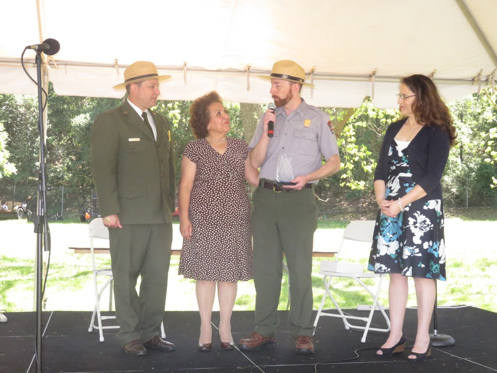 National Park Service rangers award Sandra Candanosa (center) the Hartzog Award during the John Muir Birthday-Earth Day Celebration at the John Muir National Historic Site in Martinez, Saturday, April 23. At far right is Martinez City Councilwoman Anamarie Avila Farias. (DAVID SCHOLZ / Martinez Tribune)