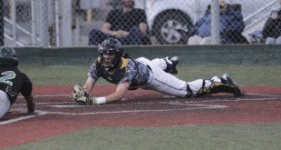 Alhambra catcher Josh Abraham dives for home plate after a wild pitch to make the tag at home plate in the Bulldogs' 6-1 win over the El Cerrito Gauchos on Tuesday, April 5, 2016. (MARK FIERNER / Martinez Tribune)