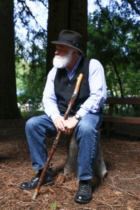 Frank Helling, as John Muir, sits in the forest and shares stories from his past adventures during the celebration. (EMILIA ROSALES / Martinez Tribune)