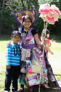 Daniela Arenas, John Swett Elementary fourth grader, standing with her younger brother, wears her home-made, all-recyclable dress for the Recycled Fashion Show. (EMILIA ROSALES / Martinez Tribune)