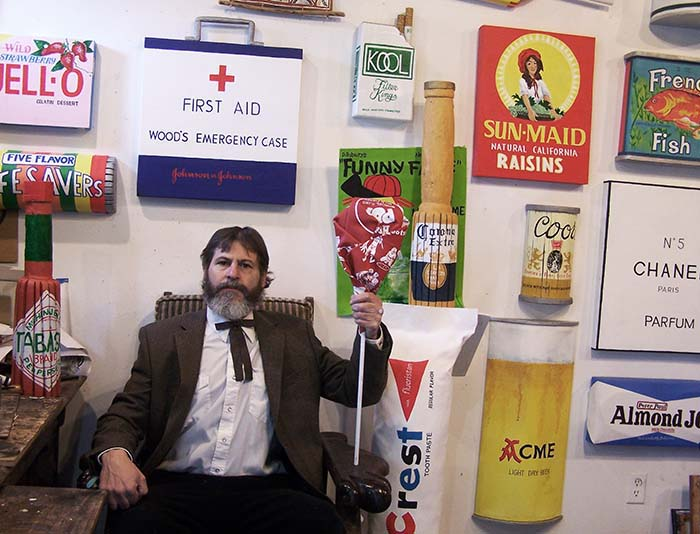 "Tim Sharman in front of a collection of his ""Folk Pop"" art. (TIM SHARMAN / Courtesy)"