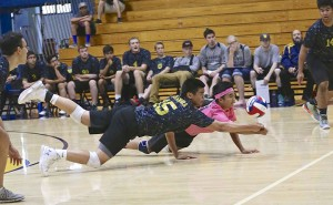 Alhambra's Jerald Jianoran (left) and Allin Torio (pink) lay out for a dig in the Bulldogs' 3-1 win over Del Oro-Loomis on May 24, 2016, in the first round of the Nor Cal CIF Volleyball playoffs. (MARK FIERNER / Martinez Tribune )