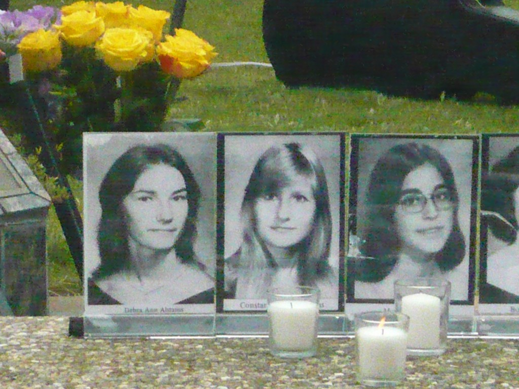 Black and white photos of students who died in the Yuba City Union High School bus crash were placed on the permanent memorial as part of a 40th anniversary observance at Waterfront Park, Saturday, May 21, 2016, in Martinez. (DAVID SCHOLZ / Martinez Tribune)